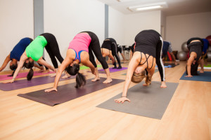 Large group of people in a yoga studio